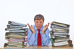 Man studies sitting between folders with files Royalty Free Stock Photography