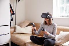 Man In Studio Wearing Virtual Reality Headset Playing Game Royalty Free Stock Photos