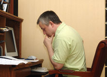 The man in study. The man works over the manuscript in study royalty free stock photos