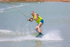 Man study wakeboarding on a blue lake Royalty Free Stock Images