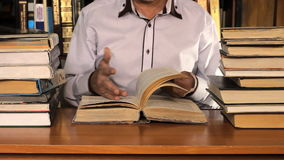 Man studying among the books stock video footage