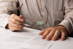 Man studying contract Royalty Free Stock Image