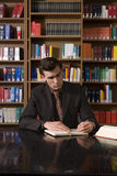 Man Studying At Desk In Library Royalty Free Stock Photography
