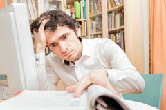 Man Studying Documents in Home Office Royalty Free Stock Images