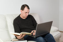 Man studying from home Stock Photo