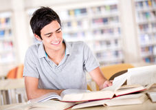 Man studying at the library Stock Photos