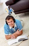 Man studying and listening to music Royalty Free Stock Photos