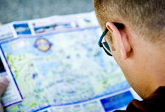 Man studying a map. Man studying a map on vacation Royalty Free Stock Photo