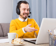 Man studying at online courses. Male student having a productive day at online courses at home Stock Photos