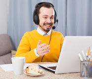 Man studying at online courses. Young male student studying at online courses productively at home Stock Photo