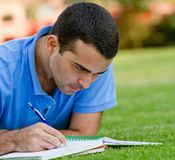 Man studying outdoors Stock Images