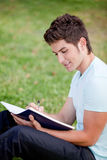Man studying outdoors Stock Photo