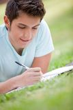Man studying outdoors Stock Image