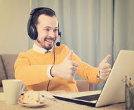 Man studying remotely at home. Man distance learning and pleased with decision tasks at home Stock Photography