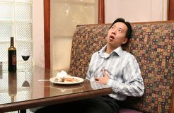 Man Stuffed After Lunch Stock Photography