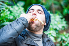 Man stuffing his face with food and feeling nice Royalty Free Stock Photography