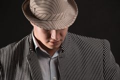 The man in style Chicago  gangster on dark background Royalty Free Stock Image