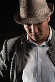 The man in style Chicago  gangster on dark background Royalty Free Stock Photo