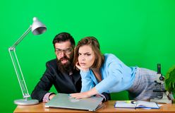 Man of style and status. secretary with boss at workplace. sexy woman and man work in office at laptop. business couple. Man of style and status. secretary with royalty free stock images