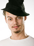 Man in stylish black hat. With  mustache and goatee Royalty Free Stock Photography