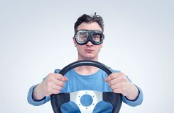 Man in stylish goggles with steering wheel, car driver concept Stock Images