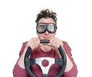 Man in stylish goggles with steering wheel, isolated on white background. Car driver concept.  Royalty Free Stock Photos