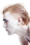 Man with a stylish haircut and silver makeup Royalty Free Stock Photo