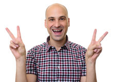 Man in stylish shirt showing victory sign. Isolated. Young man in stylish shirt while showing the victory sign and looking at the camera. Isolated on white Royalty Free Stock Photo