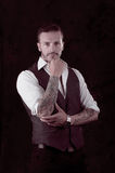 Man with stylish suit and tattoos Royalty Free Stock Image