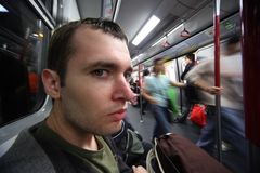 Man in subway car. Close-up portrait of young man in subway car. Ultra-wide angle Royalty Free Stock Image