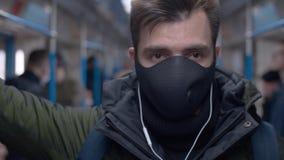 Man in subway car with headphones