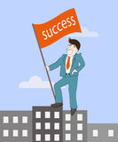 Man with success flag standing on top building, Stock Image