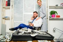 Man successful businessman phone conversation while assistant do shoulders massage. Businessman rich bearded guy sit. Office with lot of cash money. Office royalty free stock photos