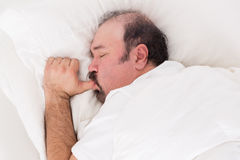 Man sucking his thumb while sleeping Stock Image