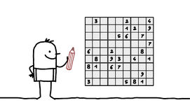 Man & sudoku Stock Photos