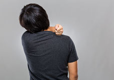 Man suffer from sholder pain. Man suffer from shoulder pain with gray background Royalty Free Stock Image