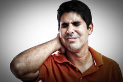 Man sufferinf neck and back pain Royalty Free Stock Photography