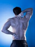 Man suffering from back pain Stock Photos