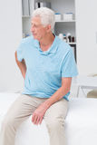 Man suffering from backache in clinic Royalty Free Stock Photo