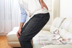 Man suffering from backache Stock Photos