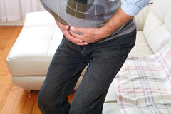 Man suffering from belly-ache Stock Photography