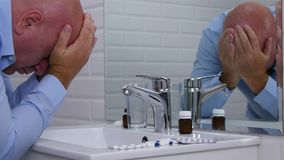 Man Suffering a Big Headache in Front of Bathroom Mirror.  stock footage
