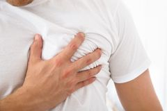 Man suffering from chest pain Royalty Free Stock Photo