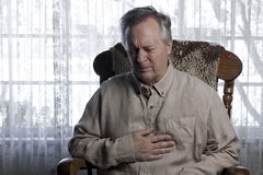 Man Suffering with Chest Pain Stock Photo