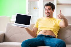 The man suffering from extra kilos in dieting concept. Man suffering from extra kilos in dieting concept stock photo
