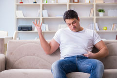 The man suffering from extra weight in diet concept. Man suffering from extra weight in diet concept Royalty Free Stock Photos