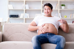 The man suffering from extra weight in diet concept. Man suffering from extra weight in diet concept Stock Photos