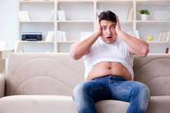 The man suffering from extra weight in diet concept Stock Photos