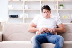 The man suffering from extra weight in diet concept Royalty Free Stock Image