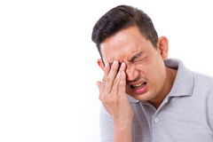 Man suffering from eye sickness Stock Photography